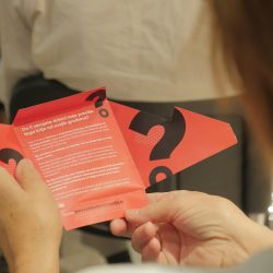 Girl reading flyer on Free Access to Information